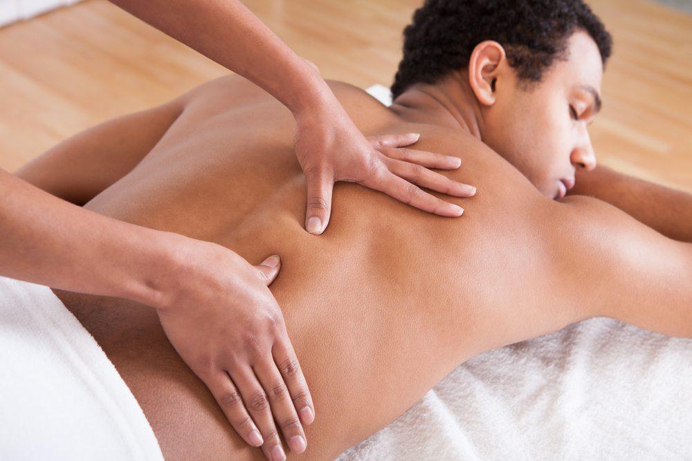 man on massage table