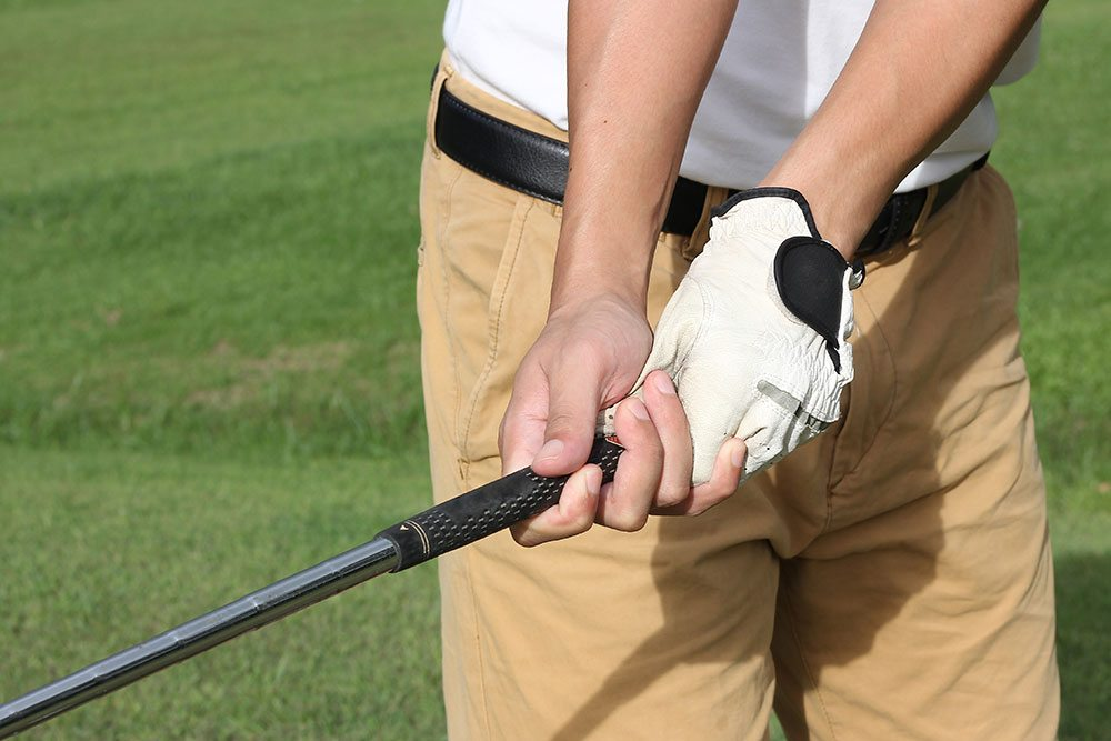 Male golfer holding golf club
